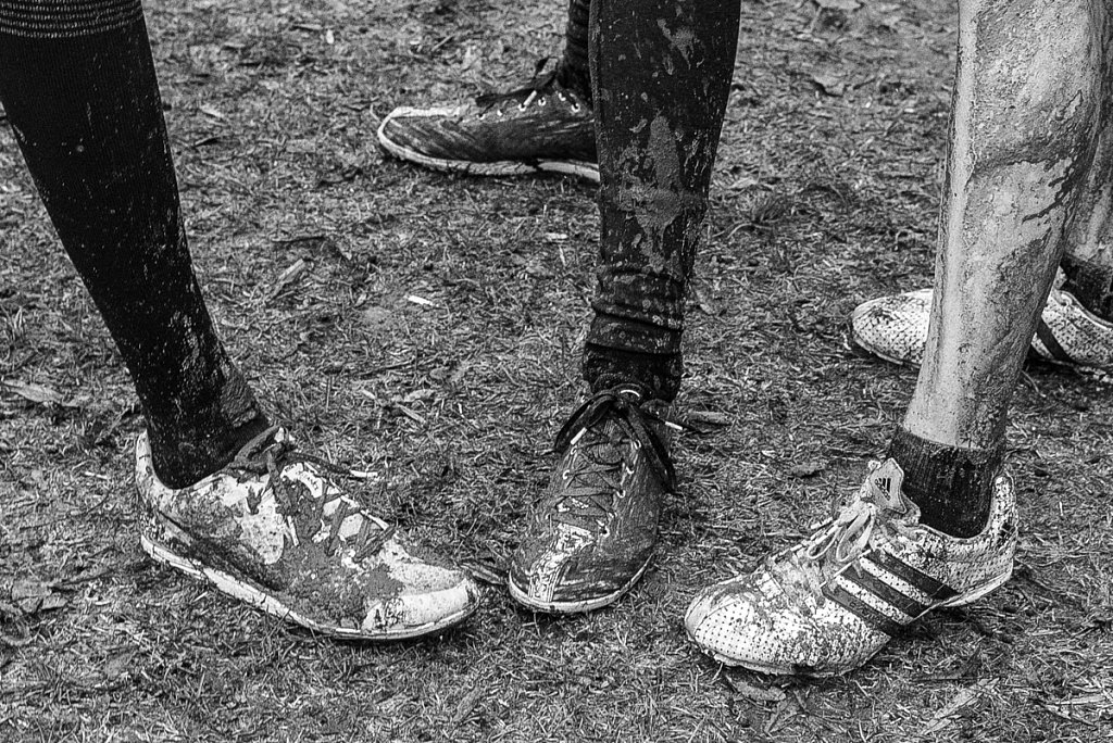 Covered in mud - Legs of young athlete girl